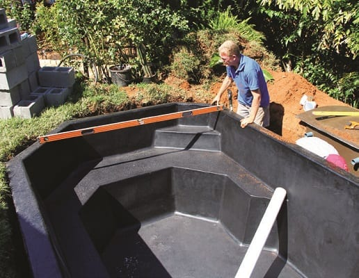 inserting the koi pond